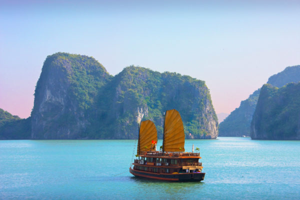 A junk cruising across Halong Bay